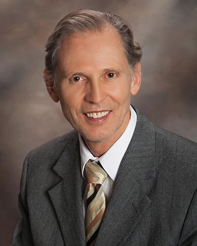 Dr. JOHN LOVELL, MD
